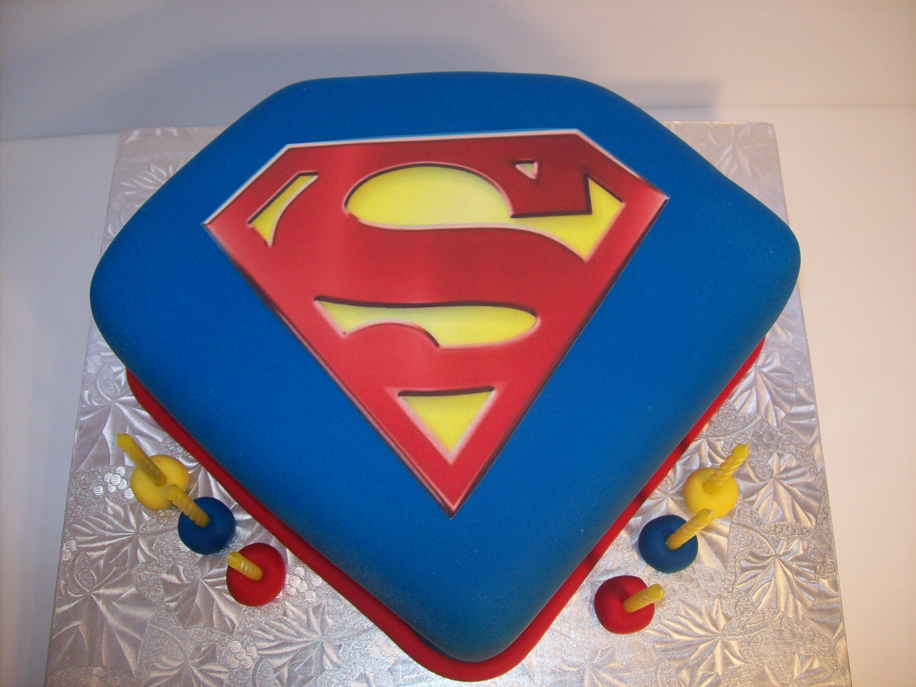 Superman pink logo cake ideas and designs for Superman template for cake