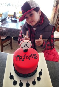 travis with cake