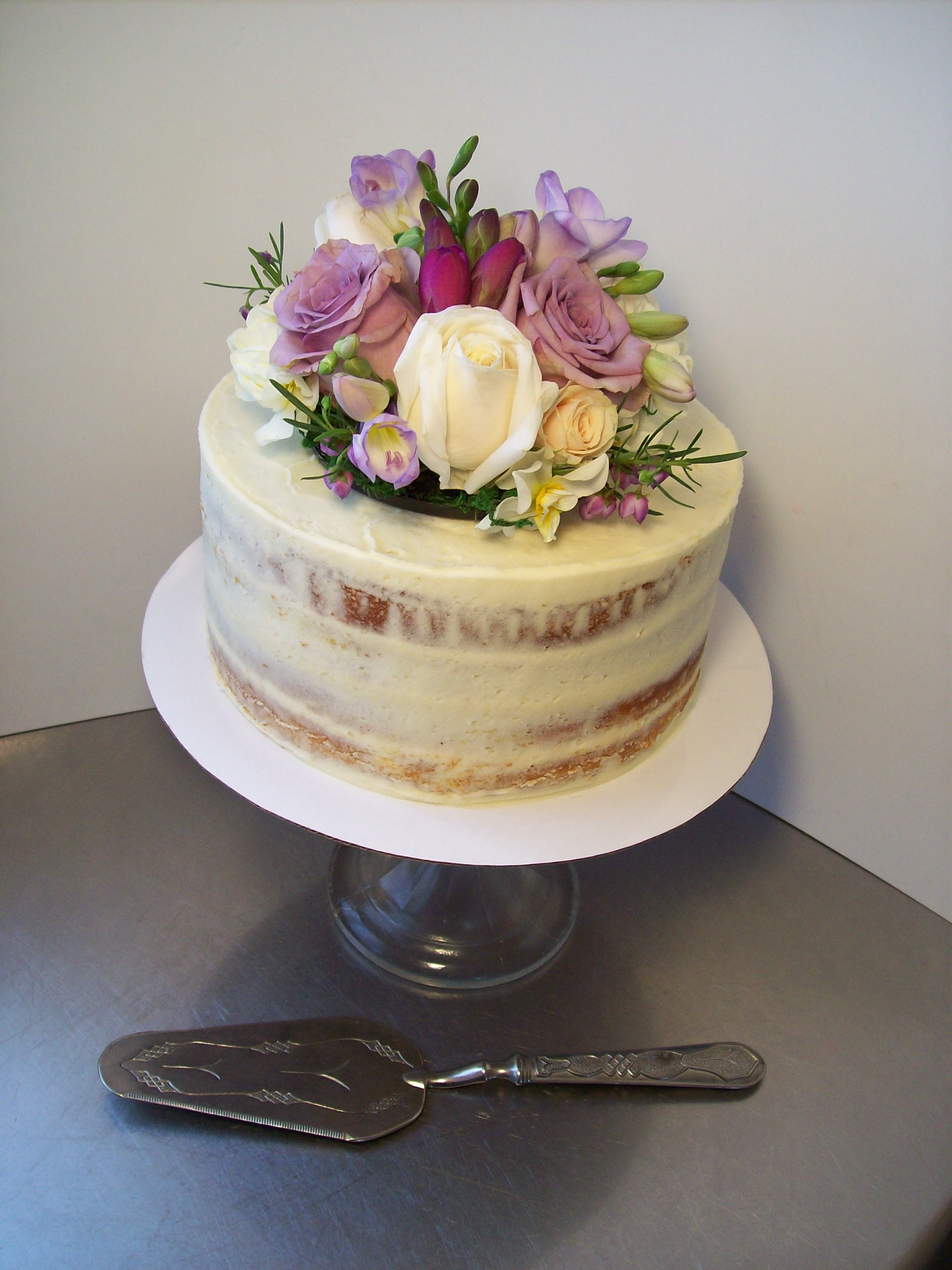 4 Tier Wedding Cake $595 (flowers not included